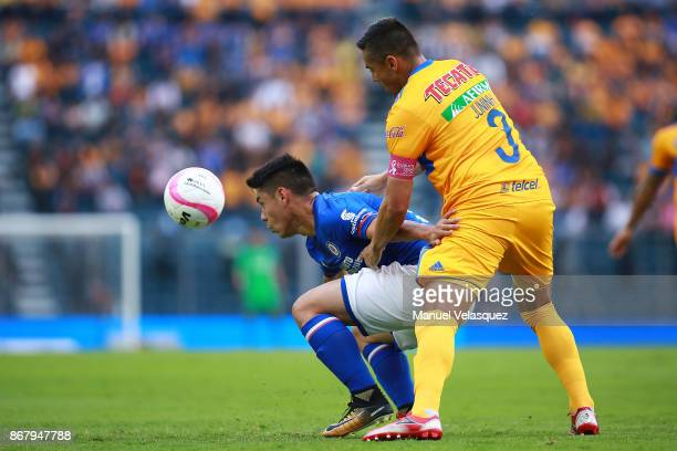 Felipe Mora of Cruz Azul struggles for the ball against Juninho of Tigres during the 15th round match between Cruz Azul and Tigres UANL as part of...