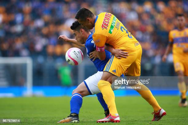 Felipe Mora of Cruz Azul struggles for the ball with Juninho of Tigres during the 15th round match between Cruz Azul and Tigres UANL as part of the...