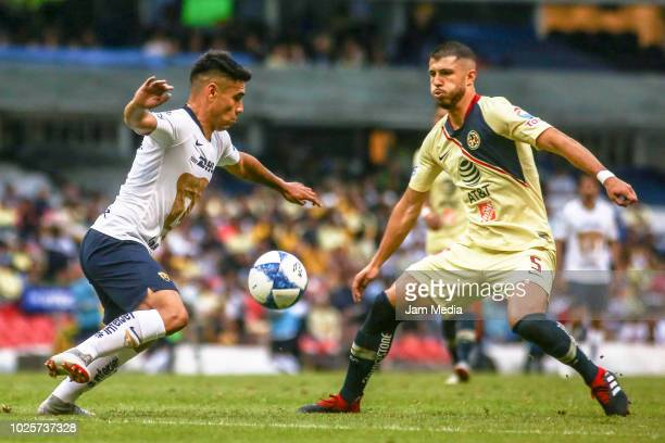 Felipe Mora of Pumas and Guido Rodriguez of America fight for the ball during the 7th round match between America and Pumas UNAM as part of the...