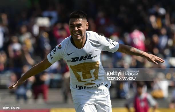 Felipe Mora of Pumas celebrates after scoring against Atlas during their Mexican Clausura tournament football match at the Olimpico Universitario...