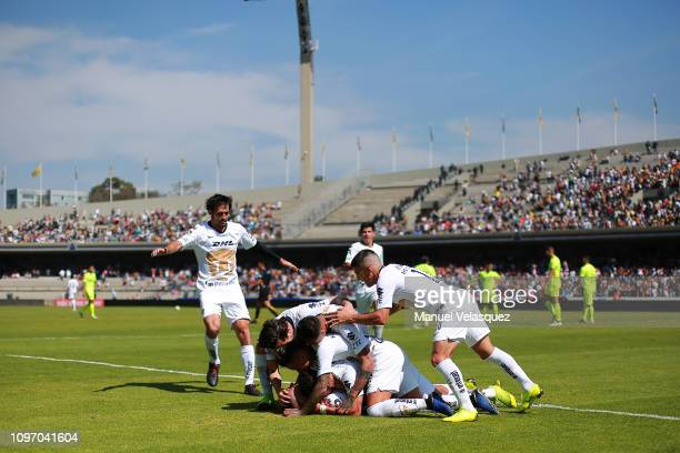 Felipe Mora of Pumas celebrates with his teammates after scoring the second goal of his team during the 3rd round match between Pumas UNAM and Atlas...