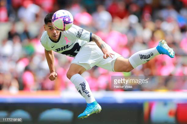Felipe Mora of Pumas heads the ball during the 14th round match between Pumas UNAM and Leon as part of the Torneo Apertura 2019 Liga MX at Olimpico...