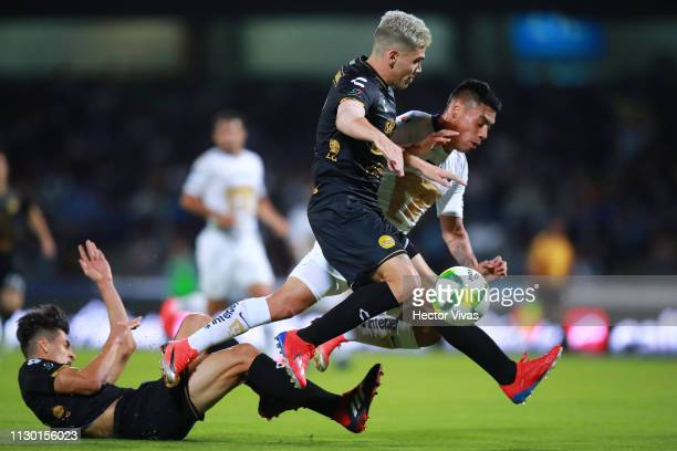 Felipe Mora of Pumas struggles for the ball with Gustavo Canto of Dorados de Sinaloa during the quarterfinals match between Pumas UNAM and Dorados as...
