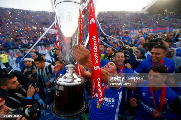 Felipe Mora of Universidad de Chile lifts the championship cup after winning a match between Universidad de Chile v San Luis de Quillota as part of...