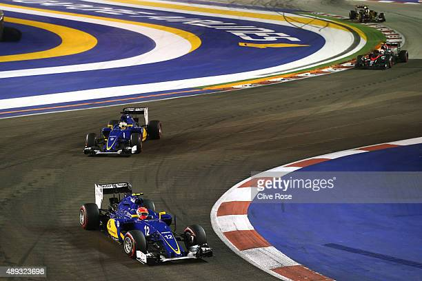 Felipe Nasr of Brazil and Sauber F1 drives ahead of Marcus Ericsson of Sweden and Sauber F1 during the Formula One Grand Prix of Singapore at Marina...