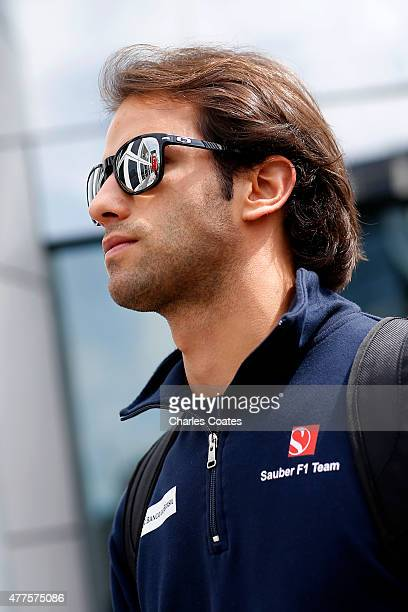 Felipe Nasr of Brazil and Sauber F1 walks through the paddock during previews to the Formula One Grand Prix of Austria at Red Bull Ring on June 18...