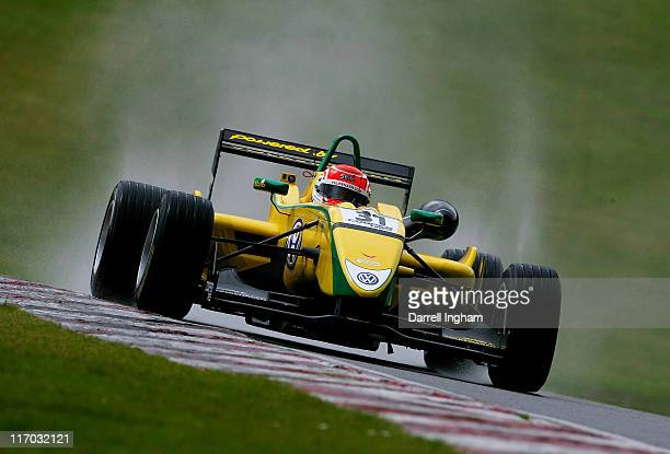 Felipe Nasr of Brazil drives the Carlin Motorsport Dallara F308 Volkswagen to victory in the rain during the Cooper Tires British Formula 3...