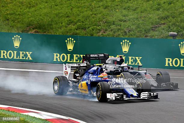 Felipe Nasr of Brazil driving the Sauber F1 Team Sauber C35 Ferrari 059/5 turbo locks a wheel next to Jenson Button of Great Britain driving the...