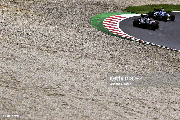 Felipe Nasr of Brazil driving the Sauber F1 Team Sauber C35 Ferrari 059/5 turbo leads Jenson Button of Great Britain driving the McLaren Honda...