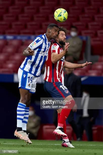 Felipe of Atletico de Madrid battle for the ball with Alexander Isak of Real Sociedad during the La Liga Santander match between Atletico de Madrid...