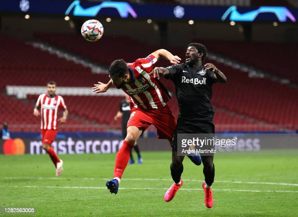 Felipe of Atletico de Madrid beats Sekou Koita of RB Salzburg toa header during the UEFA Champions League Group A stage match between Atletico Madrid...