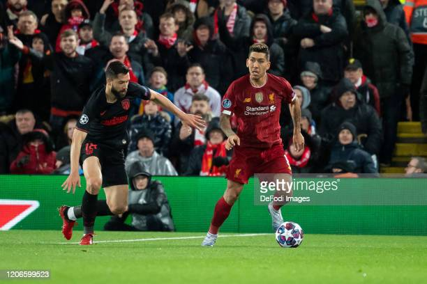 Felipe of Atletico Madrid and Roberto Firmino of Liverpool FC battle for the ball during the UEFA Champions League round of 16 second leg match...