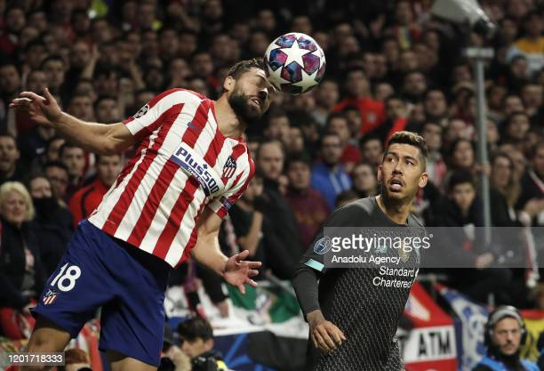 Felipe of Atletico Madrid and Roberto Firmino of Liverpool vie for the ball during the UEFA Champions League round of 16 first leg soccer match...