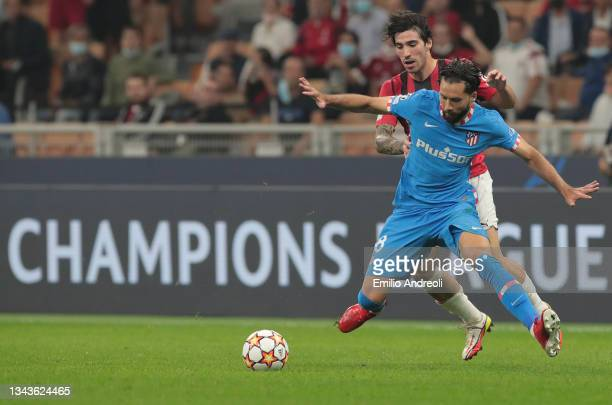 Felipe of Club Atletico de Madrid competes for the ball with Sandro Tonali of AC Milan during the UEFA Champions League group B match between AC...