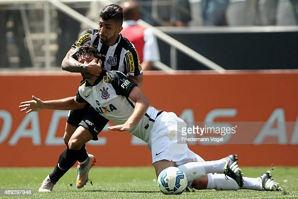 Felipe of Corinthians fights for the ball with Gabriel of Santos during the match between Corinthians and Santos for the Brazilian Series A 2015 at...