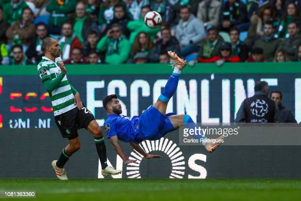 Felipe of FC Porto vies with Bas Dost of Sporting CP for the ball possession during the Liga NOS match between Sporting CP and FC Porto at Estadio...