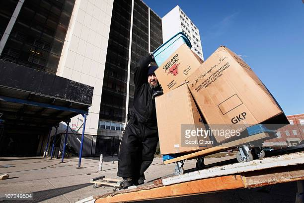 Felipe Pena helps a resident move from 1230 N Burling St the last occupied highrise in the CabriniGreen public housing complex on December 2 2010 in...