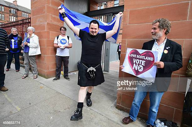 Felipe Perez walks out of polling station at Notre Dame primary school with a Saltire flag on September 18 2014 in Glasgow Scotland After many months...