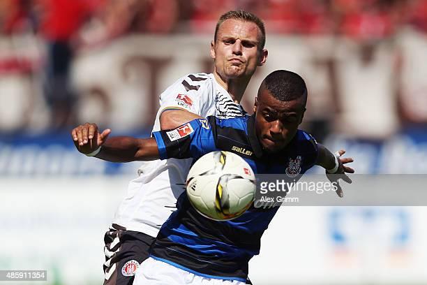 Felipe Pires of Frankfurt is challenged by Bernd Nehrig of St. Pauli during the Second Bundesliga match between FSV Frankfurt and FC St. Pauli at...