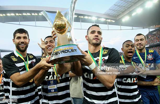 Felipe, Ralf and Renato Augusto of Corinthians celebrates with the trophy after winning the match between Corinthians and Sao Paulo for the Brazilian...