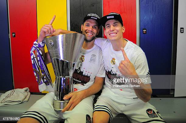 Felipe Reyes, #9 of Real Madrid and Jaycee Carroll, #20 of Real Madrid celebrate after victory against Olympiacos Piraeus in the Turkish Airlines...