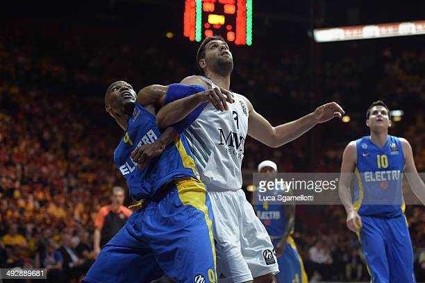 Felipe Reyes #9 of Real Madrid competes with Alex Tyus #9 of Maccabi Electra Tel Aviv during the Turkish Airlines Final Four Final game between Real...