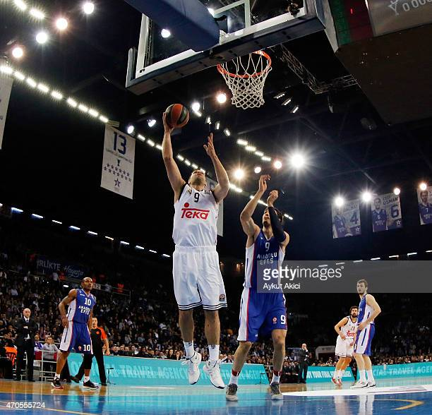 Felipe Reyes #9 of Real Madrid competes with Dario Saric #9 of Anadolu Efes Istanbul during the 20142015 Turkish Airlines Euroleague Basketball Play...
