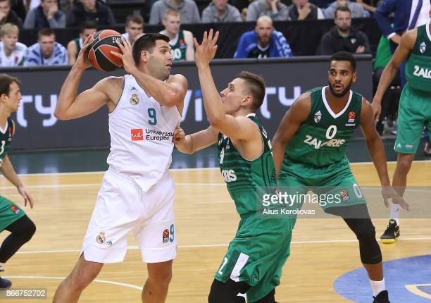 Felipe Reyes #9 of Real Madrid competes with Edgaras Ulanovas #92 of Zalgiris Kaunas in action during the 2017/2018 Turkish Airlines EuroLeague...