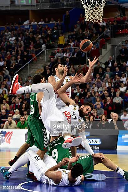 Felipe Reyes #9 of Real Madrid competes with Jeffery Taylor #44 of Real Madrid and Ioannis Bourousis #9 of Laboral Kutxa Vitoria Gasteiz in action...