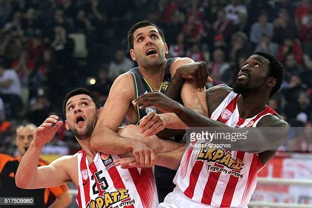 Felipe Reyes, #9 of Real Madrid competes with Kostas Papanikolau, #25 and Othello Hunter, #5 of Olympiacos Piraeus during the 2015-2016 Turkish...
