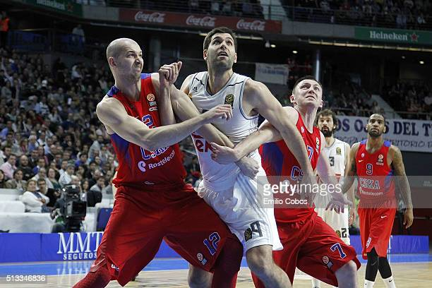 Felipe Reyes, #9 of Real Madrid competes with Pavel Korobkov, #12 of CSKA Moscow and Vitaly Fridzon, #7 of CSKA Moscow during the 2015-2016 Turkish...