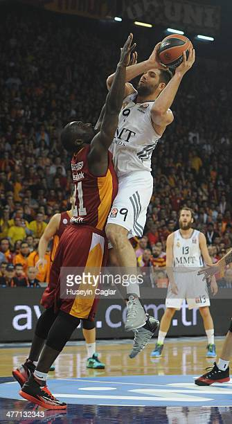 Felipe Reyes #9 of Real Madrid competes with Pops MensahBonsu #21 of Galatasaray Liv Hospital Istanbul in action during the 20132014 Turkish Airlines...