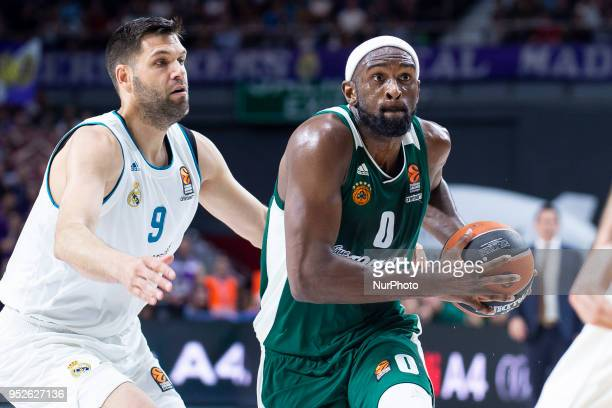 Felipe Reyes #9 of Real Madrid vies Chris Singleton of Panathinaikos Superfood during the Turkish Airlines Euroleague Play Offs Game 4 between Real...