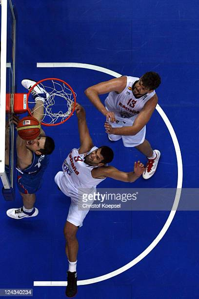 Felipe Reyes and Marco Gasol of Spain defend against Ivan Paunic of Serbia during the EuroBasket 2011 second round group E match between Spain and...