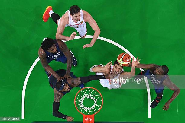 Felipe Reyes and Pau Gasol of Spain go for the rebound against Carmelo Anthony DeAndre Jordan and Kevin Durant of United States during the Men's...