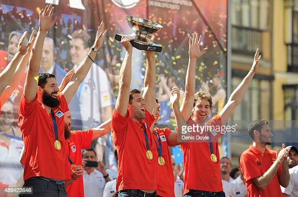 Felipe Reyes holds up the trophy during the Spain basketball team celebration after winning the EuroBasket 2015 final at Callao square on September...