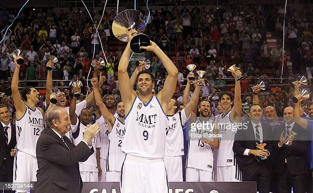 Felipe Reyes of Real Madrid holds up the trophy after winning the Supercopa ACB Final match between Real Madrid and Barcelona Regal at Principe...