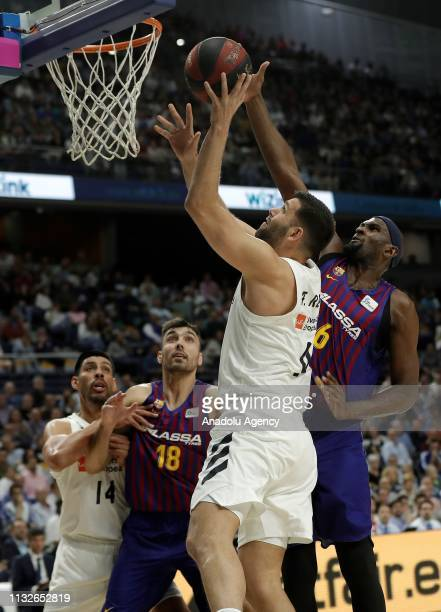 Felipe Reyes of Real Madrid in action against Chris Singleton of Barcelona Lassa during the Liga Endesa week 24 match between Real Madrid and FC...