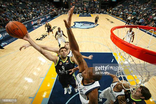 Felipe Reyes of Real Madrid shoots against Marreese Speights of the Memphis Grizzlies on October 6, 2012 at FedExForum in Memphis, Tennessee. NOTE TO...