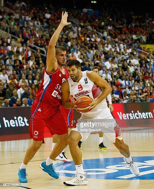 Felipe Reyes of Spain drives to the basket against Nemanja Bjelica of Serbia during the FIBA EuroBasket 2015 Group B basketball match between Spain...