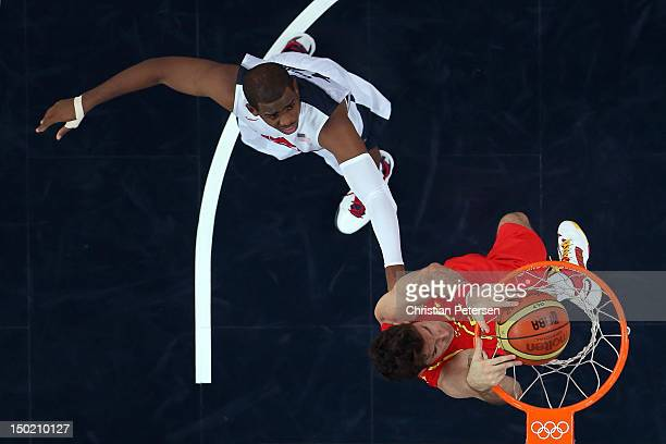 Felipe Reyes of Spain dunks over Andre Iguodala of the United States during the Men's Basketball gold medal game between the United States and Spain...