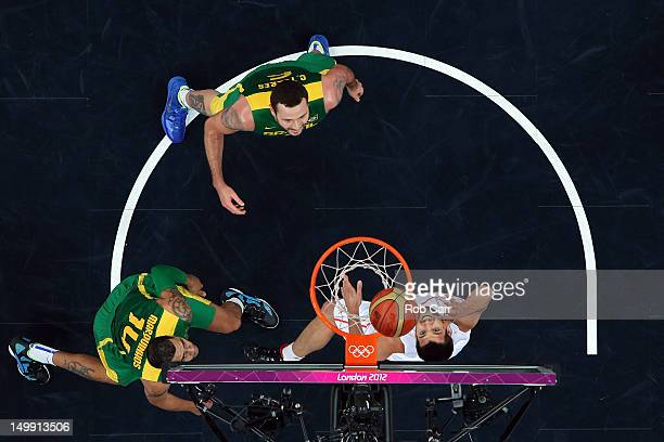 Felipe Reyes of Spain goes to the hoop against Marquinhos Vieira Sousa and Caio Torres of Brazil during the Men's Basketball Preliminary Round match...