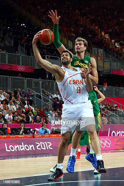 Felipe Reyes of Spain goes to the hoop against Tiago Splitter of Brazil during the Men's Basketball Preliminary Round match on Day 10 of the London...