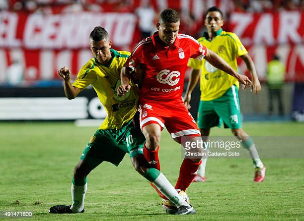Felipe Rivera of AmeŽrica de Cali fights for the ball with Alfonso Lo—pez of Leones FC during a match between America de Cali and Leones FC as part...