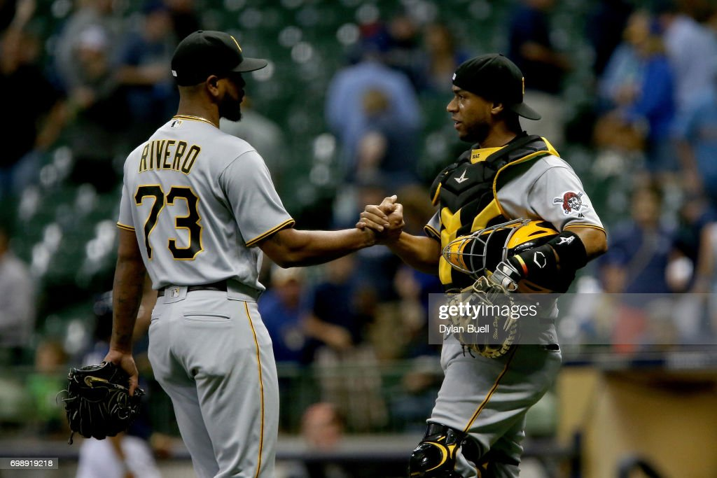 Felipe Rivero #73 and Elias Diaz #32 of the Pittsburgh Pirates celebrate after beating the Milwaukee Brewers 7-3 at Miller Park on June 20, 2017 in Milwaukee, Wisconsin.