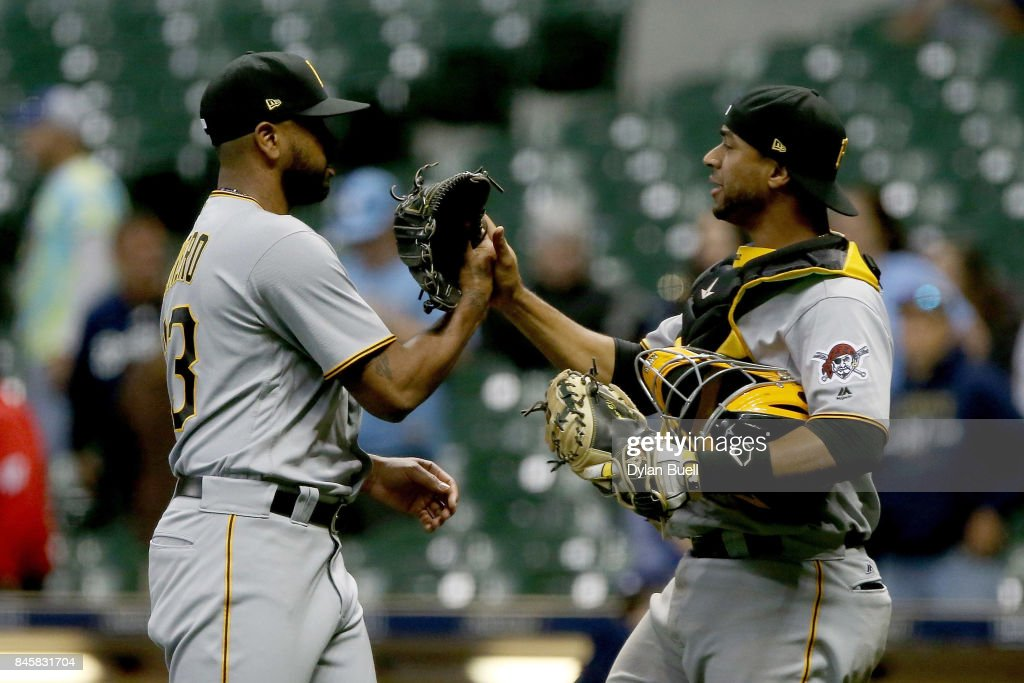 Felipe Rivero #73 and Elias Diaz #32 of the Pittsburgh Pirates celebrate after beating the Milwaukee Brewers 7-0 at Miller Park on September 11, 2017 in Milwaukee, Wisconsin.