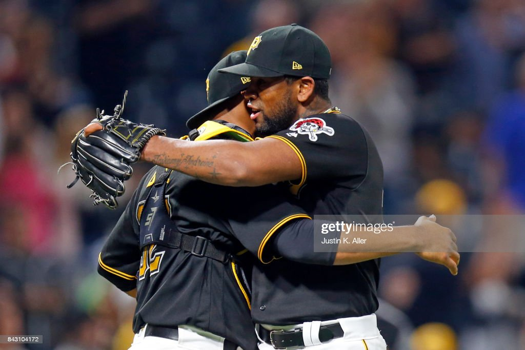 Felipe Rivero #73 and Elias Diaz #32 of the Pittsburgh Pirates celebrates after defeating the Chicago Cubs 4-3 at PNC Park on September 5, 2017 in Pittsburgh, Pennsylvania.