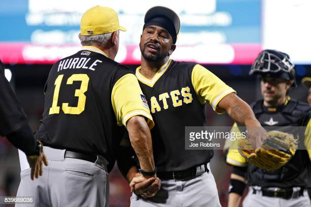 Felipe Rivero of the Pittsburgh Pirates celebrates with manager Clint Hurdle after a game against the Cincinnati Reds at Great American Ball Park on...