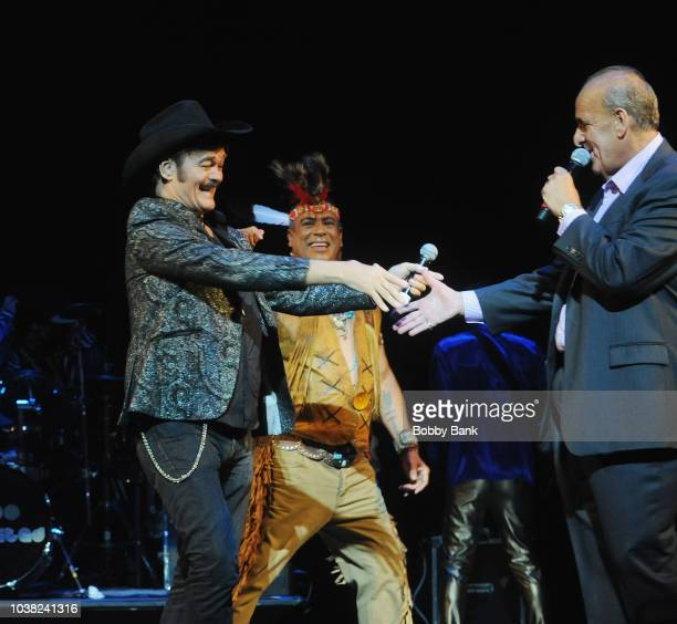 Felipe Rose and Randy Jones of The Village People reunite on stage with radio personality Joe Causi at Disco Fever 2018 at the St George Theatre on...