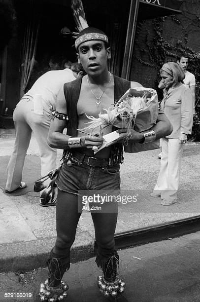 Felipe Rose from The Village People in costume signing autographs on the street circa 1970 New York